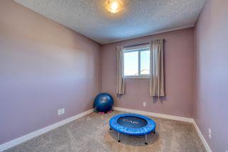 Photo 36: 110 Fireside Circle: Cochrane Semi Detached for sale : MLS®# A1073452
