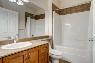 Photo 12: 4111 Garrison Boulevard SW in Calgary: Garrison Woods Row/Townhouse for sale : MLS®# A1108505