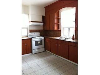 Photo 14: Duplex with 2 basement apartments