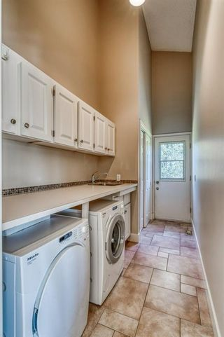 Photo 20: 555 Coach Light Bay SW in Calgary: Coach Hill Detached for sale : MLS®# A1144688