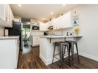 """Photo 3: 64 21928 48 AVE Avenue in Langley: Murrayville Townhouse for sale in """"Murrayville Glen"""" : MLS®# R2460485"""