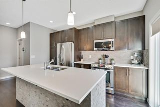 Photo 2: 1303, 881 Sage Valley Boulevard NW in Calgary: Sage Hill Row/Townhouse for sale : MLS®# A1095405