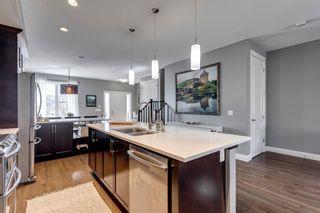 Photo 10: 212 QUARRY PARK Boulevard SE in Calgary: Douglasdale/Glen Row/Townhouse for sale : MLS®# A1095917