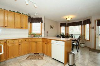 Photo 9: 185 WEST MCDOUGAL Road: Cochrane House for sale : MLS®# C4184033