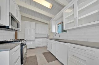 Photo 3: 1026 IOCO Road in Port Moody: Barber Street House for sale : MLS®# R2599599