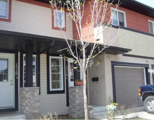 Main Photo: 153 EVERSYDE Common SW in Calgary: Evergreen Townhouse for sale : MLS®# C3386146