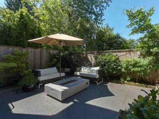 "Photo 1: 4461 WELWYN Street in Vancouver: Victoria VE 1/2 Duplex for sale in ""WELWYN MEWS"" (Vancouver East)  : MLS®# R2379938"