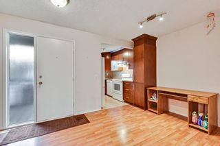 Photo 4: 105 7172 Coach Hill Road SW in Calgary: Coach Hill Row/Townhouse for sale : MLS®# A1053113