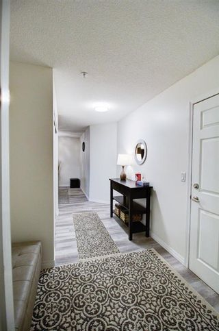 Photo 2: 209 2022 CANYON MEADOWS Drive SE in Calgary: Queensland Apartment for sale : MLS®# A1028544