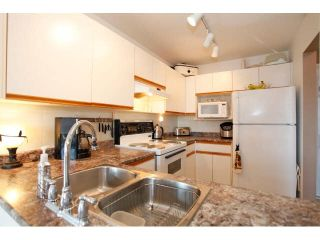 "Photo 8: 311 5955 177B Street in Surrey: Cloverdale BC Condo for sale in ""WINDSOR PLACE"" (Cloverdale)  : MLS®# F1433073"