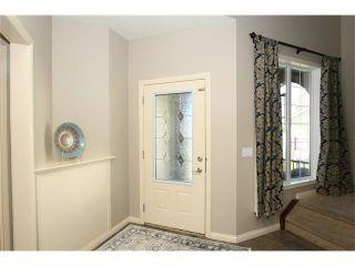 Photo 2: 188 SUNSET Close: Cochrane House for sale : MLS®# C4115906