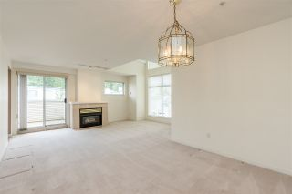 """Photo 2: 404 19131 FORD Road in Pitt Meadows: Central Meadows Condo for sale in """"WOODFORD MANOR"""" : MLS®# R2372445"""
