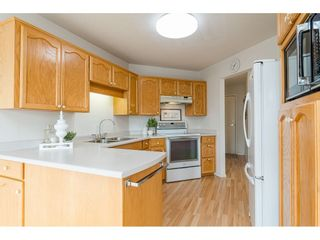 """Photo 6: 204 5375 205 Street in Langley: Langley City Condo for sale in """"Glenmont Park"""" : MLS®# R2500306"""