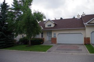 Photo 1: 308 PROMINENCE Heights SW in Calgary: Patterson Semi Detached for sale : MLS®# A1037279