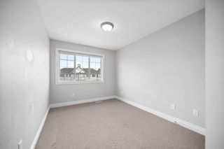 Photo 21: 5 Cougar Ridge Mews SW in Calgary: Cougar Ridge Row/Townhouse for sale : MLS®# A1105171