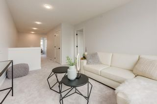 Photo 26: 249 Lucas Avenue NW in Calgary: Livingston Row/Townhouse for sale : MLS®# A1102463