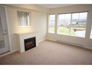 "Photo 2: 325 19673 MEADOW GARDENS Way in Pitt Meadows: North Meadows PI Condo for sale in ""THE FAIRWAYS"" : MLS®# V924637"
