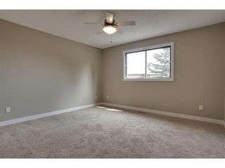 Photo 14: 4 WOODBROOK Way SW in Calgary: Bungalow for sale : MLS®# C3517374