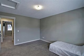 Photo 23: 161 Rainbow Falls Manor: Chestermere Row/Townhouse for sale : MLS®# A1083984