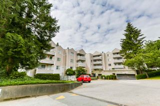 """Photo 1: 102 9644 134 Street in Surrey: Whalley Condo for sale in """"Parkwoods - Fir"""" (North Surrey)  : MLS®# R2270857"""