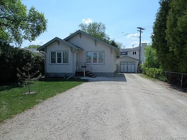 IMMACULATE 823 sq.ft Bungalow with front drive 2 BR, 1 Bath, Finished Recroom, Commercial Zoning