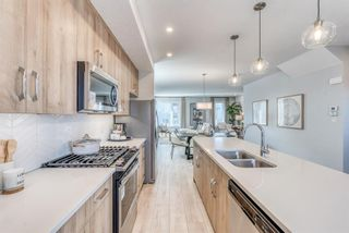 Photo 6: 146 Shawnee Common SW in Calgary: Shawnee Slopes Row/Townhouse for sale : MLS®# A1099355