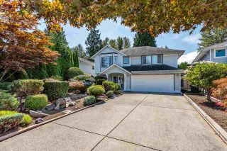 Photo 1: 19422 CUSICK Crescent in Pitt Meadows: Mid Meadows House for sale : MLS®# R2493734