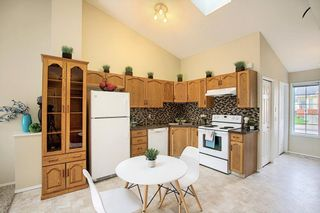 Photo 3: 8 12 Woodside Rise NW: Airdrie Row/Townhouse for sale : MLS®# A1108776
