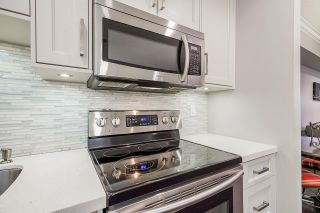 Photo 8: 319 12101 80 AVENUE in Surrey: Queen Mary Park Surrey Condo for sale : MLS®# R2516897