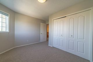 Photo 21: 21 RICHELIEU Court SW in Calgary: Lincoln Park Row/Townhouse for sale : MLS®# A1013241