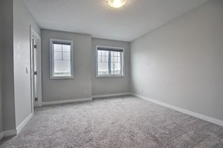 Photo 21: 102 Clydesdale Way: Cochrane Row/Townhouse for sale : MLS®# A1117864