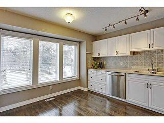 Photo 7: 262 REGAL Park NE in Calgary: Renfrew_Regal Terrace Townhouse for sale : MLS®# C3650275