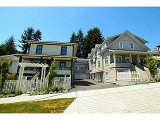 """Photo 1: 101 218 BEGIN Street in Coquitlam: Maillardville House for sale in """"BEGIN SQUARE"""" : MLS®# V1132326"""