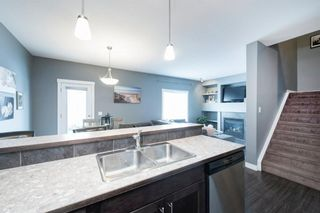 Photo 7: 407 Ranch Ridge Meadow: Strathmore Row/Townhouse for sale : MLS®# A1074181