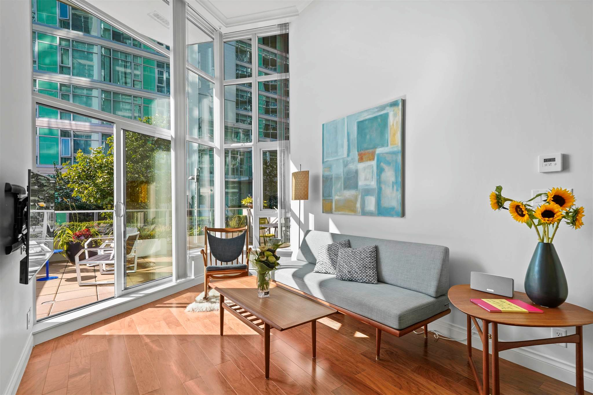 """Main Photo: 102 199 VICTORY SHIP Way in North Vancouver: Lower Lonsdale Condo for sale in """"The Trophy"""" : MLS®# R2607442"""