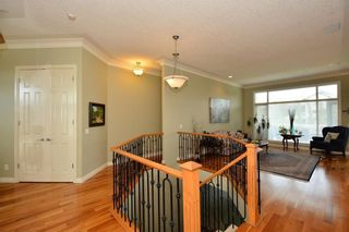 Photo 6: 104 GLENEAGLES Landing: Cochrane House for sale : MLS®# C4127159