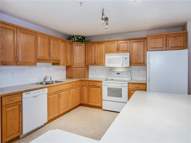 Photo 5: Photos: 1201 303 ARBOUR CREST Drive NW in Calgary: Arbour Lake Condo for sale : MLS®# C3650981