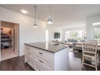 """Photo 16: 204 16380 64TH Avenue in Surrey: Cloverdale BC Condo for sale in """"The Ridge at Bose Farm"""" (Cloverdale)  : MLS®# R2535552"""