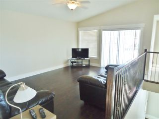 """Photo 3: 10412 109 Street in Fort St. John: Fort St. John - City NW 1/2 Duplex for sale in """"SUNSET RIDGE"""" (Fort St. John (Zone 60))  : MLS®# R2415787"""