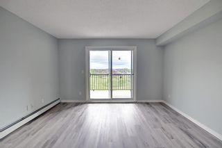 Photo 12: 7312 304 Mackenzie Way: Airdrie Apartment for sale : MLS®# A1118474
