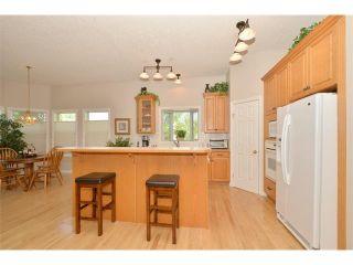 Photo 7: 134 GLENEAGLES View: Cochrane House for sale : MLS®# C4018773