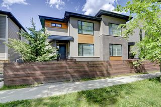 Photo 1: 1 310 12 Avenue NE in Calgary: Crescent Heights Row/Townhouse for sale : MLS®# A1112547