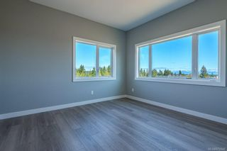 Photo 33: SL 28 623 Crown Isle Blvd in Courtenay: CV Crown Isle Row/Townhouse for sale (Comox Valley)  : MLS®# 874147