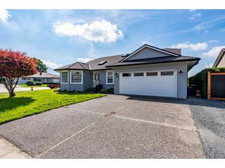 Main Photo: 7006 COACH LAMP Drive in Sardis: Sardis West Vedder Rd House for sale : MLS®# R2620773
