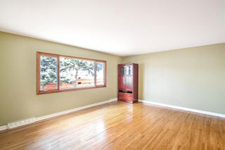 Photo 5: 7103 5 Street SW in Calgary: Kingsland Detached for sale : MLS®# A1093853