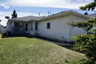 Photo 2: 113 Edgar Avenue NW: Turner Valley Semi Detached for sale : MLS®# A1101043