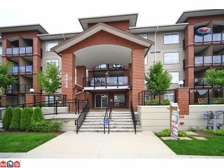 """Photo 1: 405 5516 198 Street in Langley: Langley City Condo for sale in """"Madison Villa"""" : MLS®# R2229071"""
