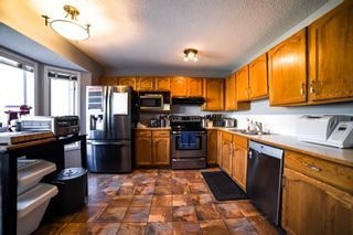 Photo 7: 113 Bedford Manor NE in Calgary: Beddington Heights Row/Townhouse for sale : MLS®# A1095621