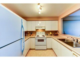 """Photo 6: 305 1199 WESTWOOD Street in Coquitlam: North Coquitlam Condo for sale in """"THE CRESCENT"""" : MLS®# V1052565"""