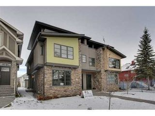 Photo 1: 2116 2 Avenue NW in Calgary: 3 Storey for sale : MLS®# C3541376